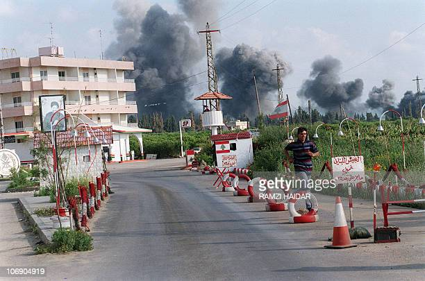 A Lebanese youth runs through a Lebanese army roadblick fleeing Israeli shelling of Cana 19 April 1996 Day before Israeli forces pummeled a compound...