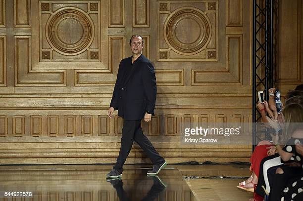 LebaneseItalian Designer Tony Ward acknowledges the audience during the Tony Ward Haute Couture Fall/Winter 20162017 show as part of Paris Fashion...