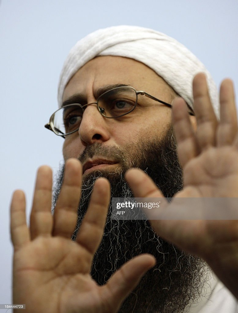 Lebaneses Salafist figure Sheikh Ahmad al-Assir speaks during a protest in the southern city of Sidon, on October 20, 2012, a day after the assassination of police intelligence chief Wissam al-Hassan in a car bomb in Ashrafieh, an upmarket mostly Christian district of the Lebanese capital Beirut. Lebanon was reeling after Hassan was killed in a bombing that was blamed on Syria and also raised fears the country is being sucked into the war ravaging its neighbour.