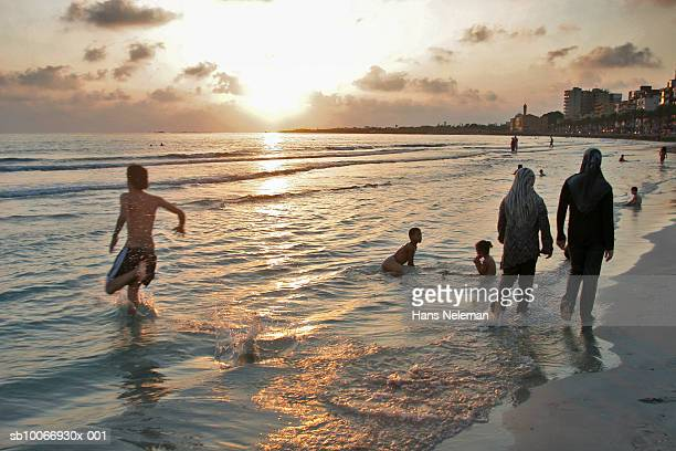Lebanon, Beirut, People in beach at dusk