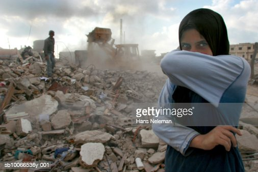 Lebanon, Sidiken, Girl in destroyed town covering mouth from ashes, portrait