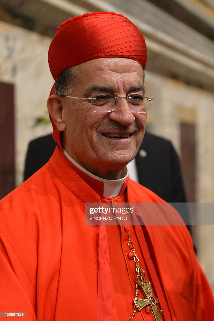 Lebanon's Bechara Boutros al-Rahi arrives to greet visitors during the courtesy visit after being appointed by the pontif on November 24, 2012 at the Apostolico palace at the Vatican. Six non-European prelates are set to join the Catholic Church's College of Cardinals, a move welcomed by critics concerned that the body which will elect the future pope is too Eurocentric. AFP PHOTO / VINCENZO PINTO