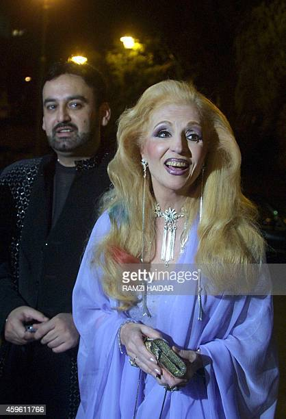 Lebanon's everyoung singer Sabah arrives with her husband Fadi Lubnan at UNESCO Palace in Beirut 12 April 2001 to attend a musical event Sabah is who...