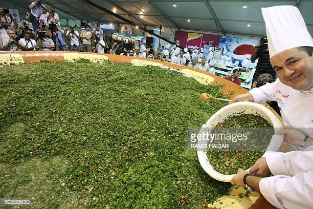 Lebanon's famous chef Ramzi Choueiry helps prepare a giant tabbouleh salad to set a new world record in Beirut on October 25 2009 While Lebanon may...