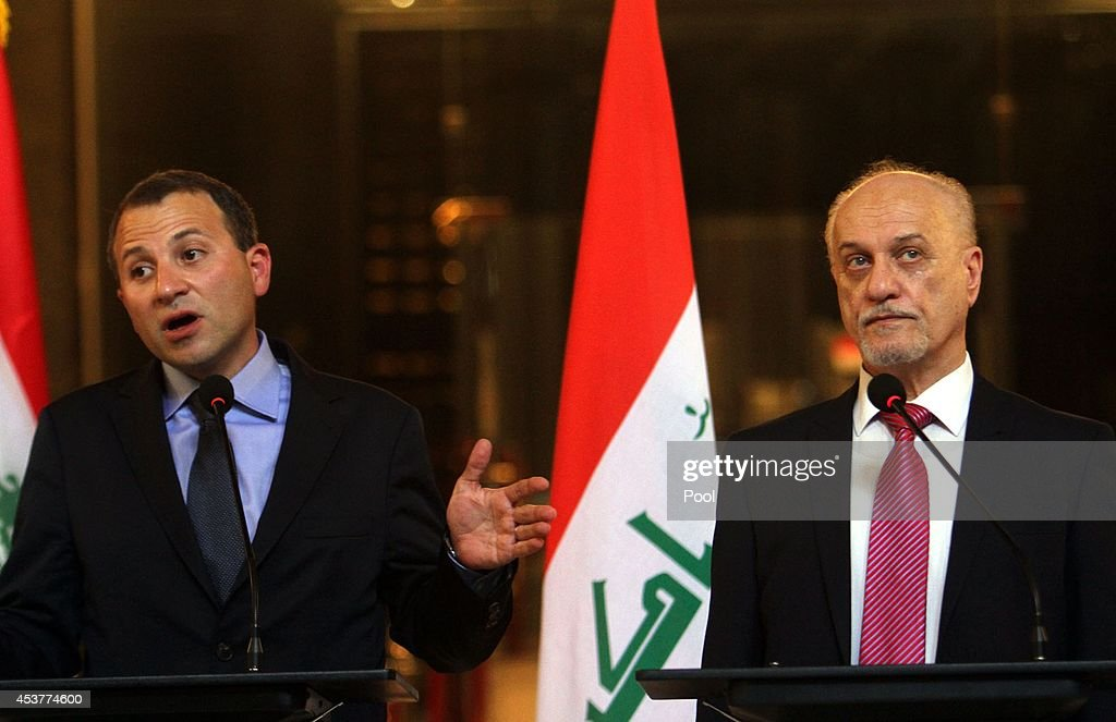 Lebanon's Foreign Minister Gebran Bassil (L) speaks during a joint press conference with Iraq's acting Foreign Minister Hussein Shahristani (R) on August 18, 2014 in Baghdad, Iraq. Bassil visited Baghdad to hold talks with senior Iraqi officials about the latest development in the area , and express his solidarity with Iraq in its war against the terrorism .