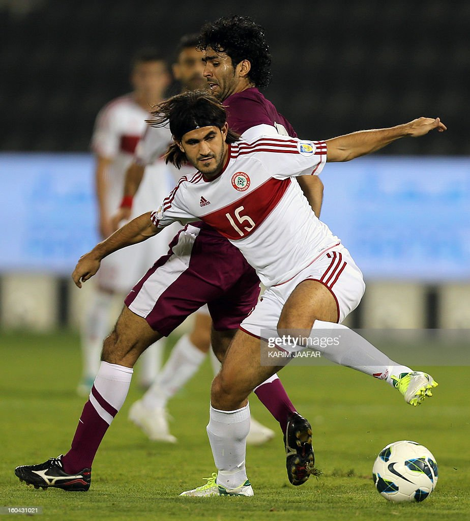 Lebanon's Haitham Faour (front) fights for the ball with Qatar's Talal al-Bloshi during their friendly football match in Doha January 31, 2013. Qatar won the match 1-0.