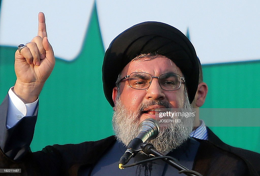 Lebanon's Hezbollah chief Hassan Nasrallah addresses thousands of supporters who took to the streets of southern Beirut to denounce a film mocking Islam on September 17, 2012. Nasrallah, who made a rare public appearance, has called for a week of protests across the country over the low-budget, US-made film, describing it as the 'worst attack ever on Islam.' AFP PHOTO / JOSEPH EID