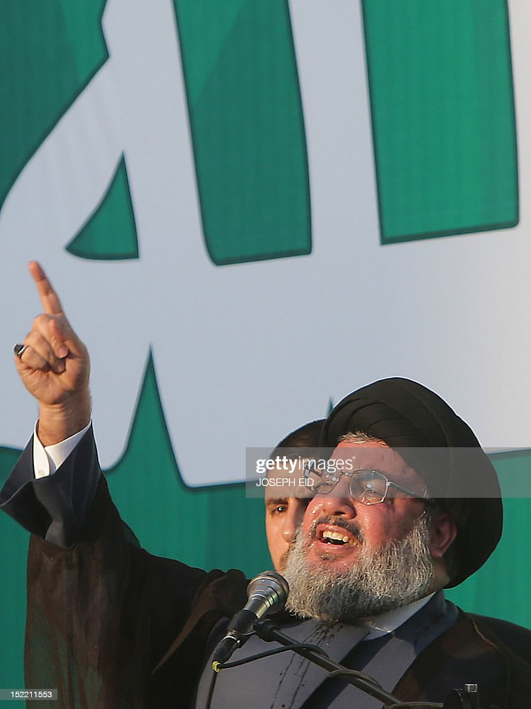 Lebanon's Hezbollah chief Hassan Nasrallah addresses thousands of supporters who took to the streets of southern Beirut to denounce a film mocking Islam on September 17, 2012. Nasrallah, who made a rare public appearance, has called for a week of protests across the country over the low-budget, US-made film, describing it as the 'worst attack ever on Islam.'