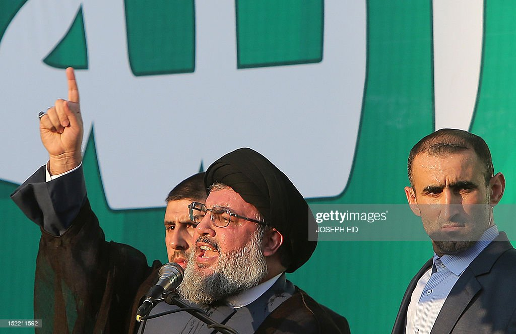 Lebanon's Hezbollah chief Hassan Nasrallah (L) addresses thousands of supporters who took to the streets of southern Beirut to denounce a film mocking Islam on September 17, 2012. Nasrallah, who made a rare public appearance, has called for a week of protests across the country over the low-budget, US-made film, describing it as the 'worst attack ever on Islam.'