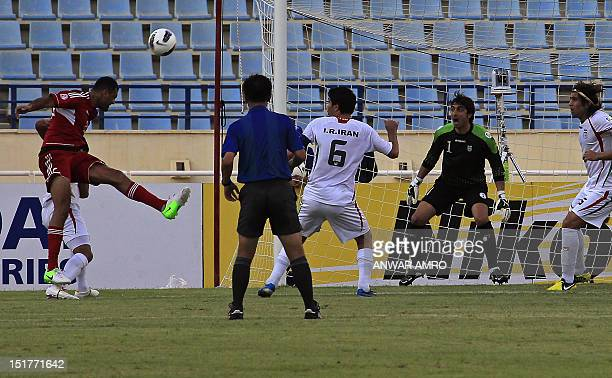 Lebanon's midfielder Roda Antar heads the ball to score a goal against Iran during their 2014 World Cup Asian zone group A qualifying football match...