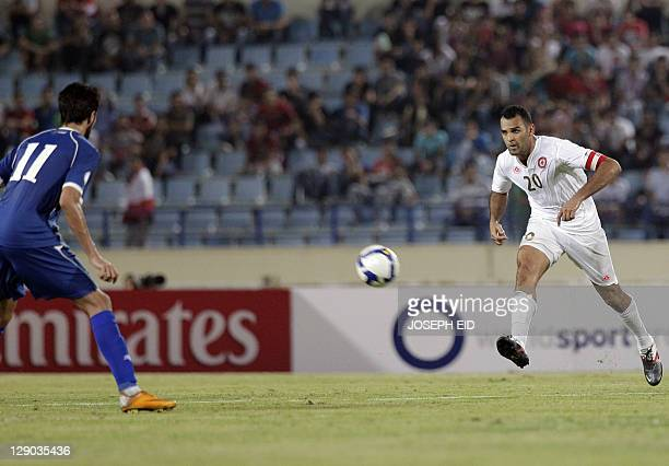 Lebanon's Midlfielder and Captain Roda Antar kicks the ball during their 2014 World Cup Asian zone qualifying football match in Beirut on October 11...