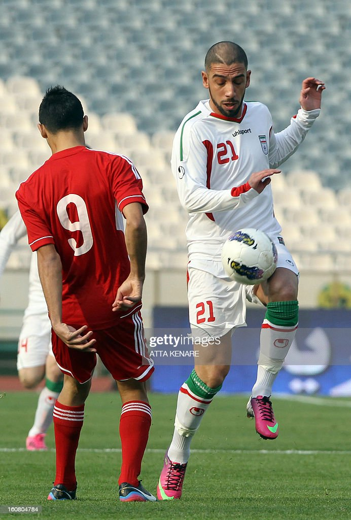 Lebanon's Mohammed Haidar (L) fights for the ball against Ashkan Dejagah (R) of Iran during their 2015 AFC Asian Cup group B qualifying football match at the Azadi Stadium in Tehran, on February 6, 2013. Iran won the match 5-0.
