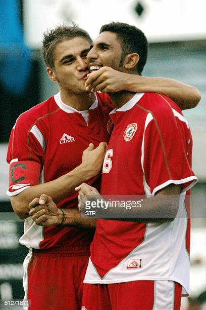 Lebanon's Nabil Baalbaki kisses Faisal Antar after he scored a goal for his team in the World Cup 2006 qualifying match between the Maldives and...