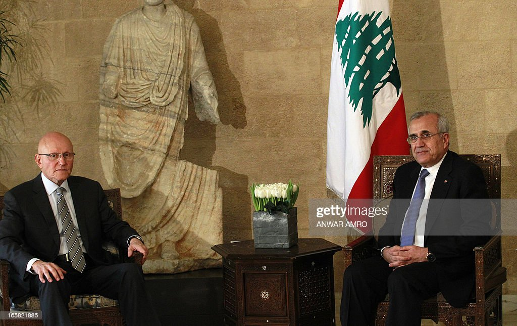Lebanon's newly named Prime Minister Tammam Salam (L) and President Michel Sleiman (R) pose for a picture at the presidential palace in Baabda east of the Lebanese capital Beirut, during the official appointment of Salam, on April 6, 2013. Salam's appointment comes two weeks after Najib Mikati resigned and effectively brought down his Hezbollah-dominated government.