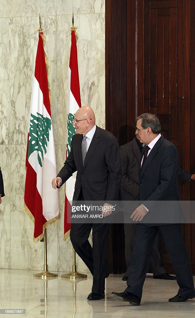Lebanon's newly named Prime Minister Tammam Salam (C) is seen following his official appointment by President Michel Sleiman (not pictured) at the presidential palace in Baabda east of the Lebanese capital Beirut on April 6, 2013. Salam's appointment comes two weeks after Najib Mikati resigned and effectively brought down his Hezbollah-dominated government. AFP PHOTO / ANWAR AMRO