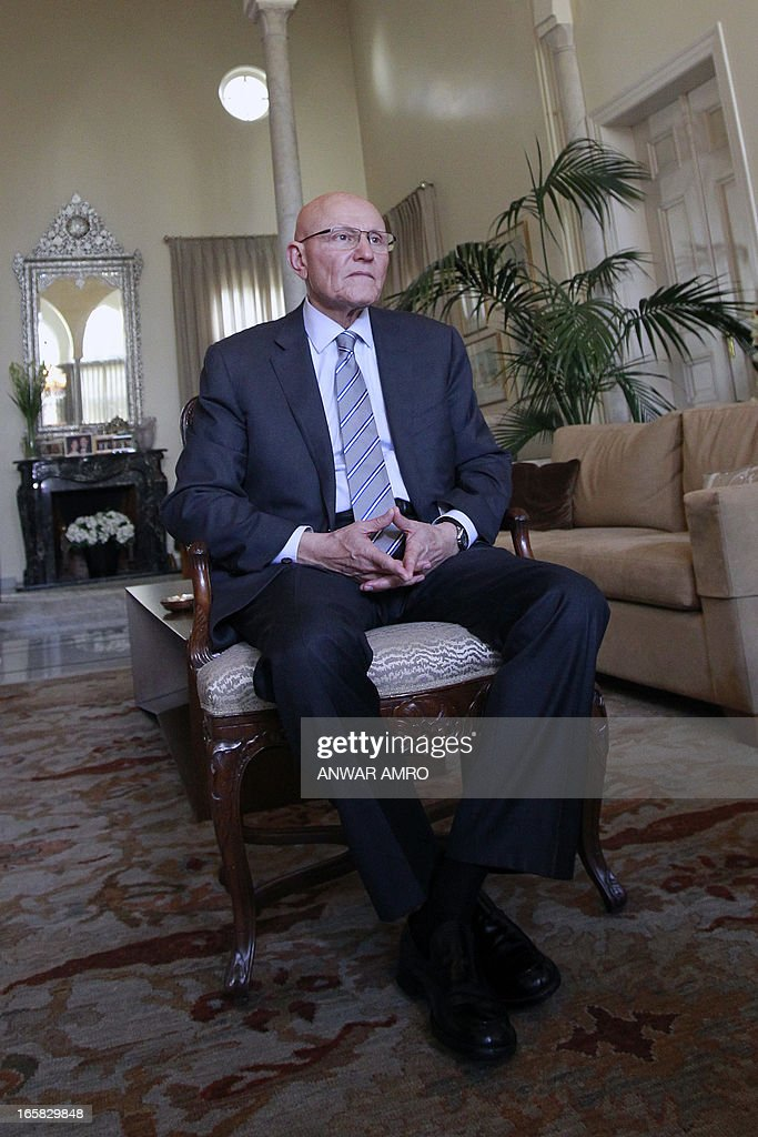 Lebanon's newly named Prime Minister Tammam Salam listens to questions of AFP's journalists during an interview following his official appointment, on April 6, 2013 at his home in the Lebanese capital Beirut. Salam's appointment comes two weeks after Najib Mikati resigned and effectively brought down his Hezbollah-dominated government.