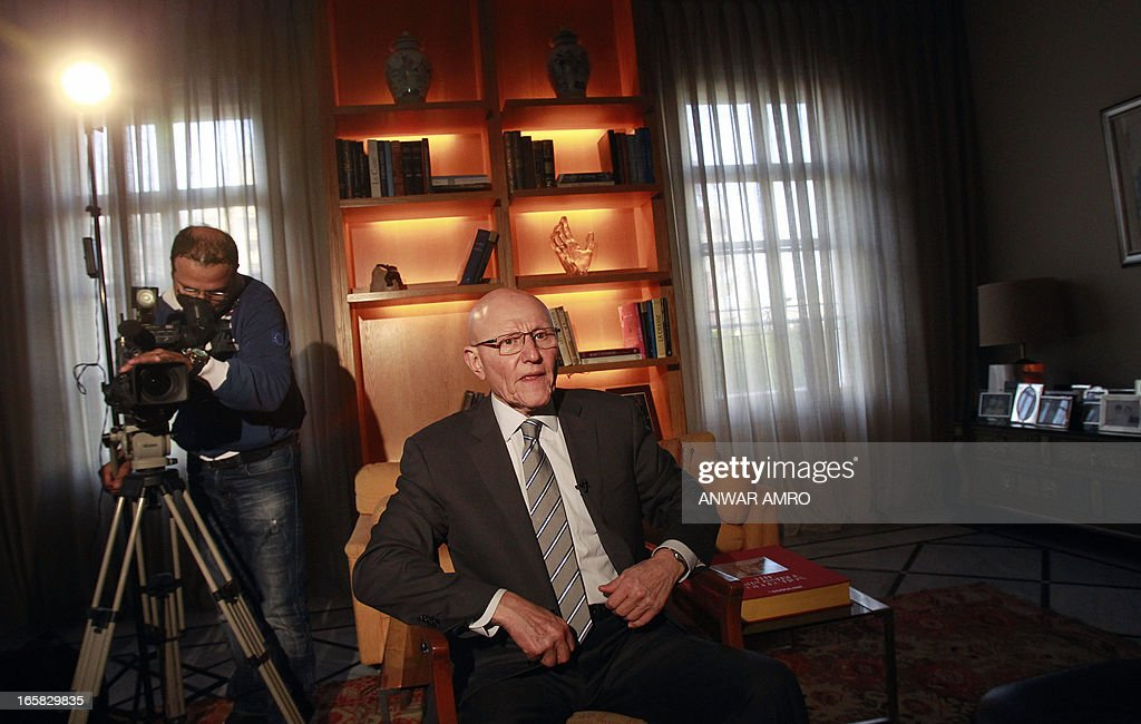 Lebanon's newly named Prime Minister Tammam Salam sits before an interview following his official appointment, on April 6, 2013 at his home in the Lebanese capital Beirut. Salam's appointment comes two weeks after Najib Mikati resigned and effectively brought down his Hezbollah-dominated government.