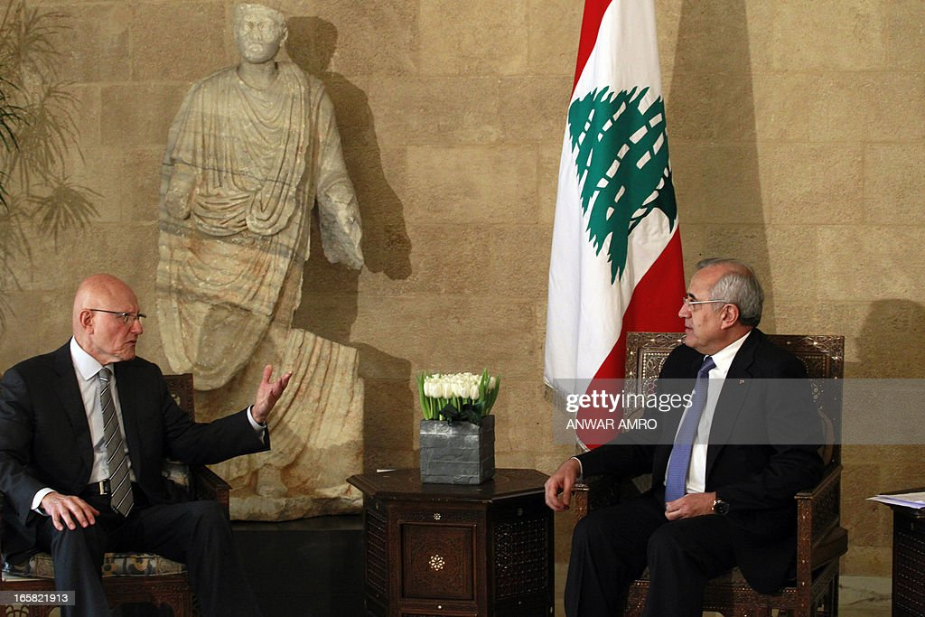 Lebanon's newly named Prime Minister Tammam Salam (L) talks with President Michel Sleiman (R) during the official appointment of Salam, at the presidential palace in Baabda east of the Lebanese capital Beirut, on April 6, 2013. Salam's appointment comes two weeks after Najib Mikati resigned and effectively brought down his Hezbollah-dominated government.