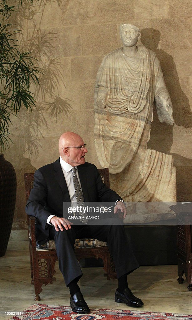 Lebanon's newly named Prime Minister Tammam Salam talks with President Michel Sleiman (not in picture) during the official appointment of Salam, at the presidential palace in Baabda east of the Lebanese capital Beirut, on April 6, 2013. Salam's appointment comes two weeks after Najib Mikati resigned and effectively brought down his Hezbollah-dominated government.