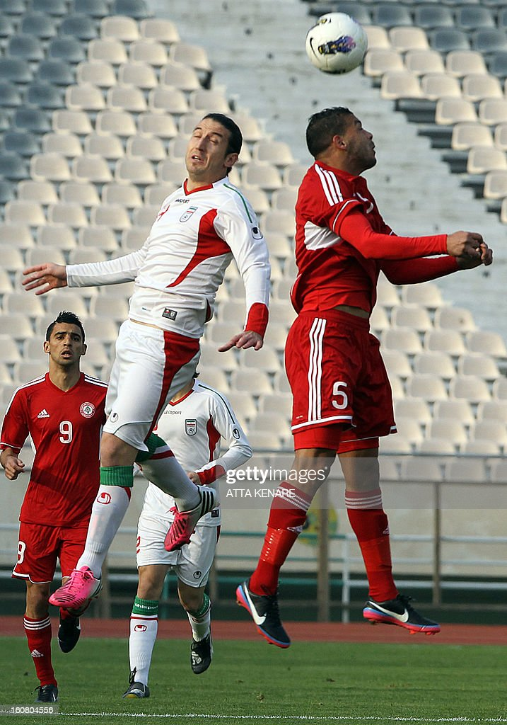 Lebanon's Nour Mansour (R) fights for the ball against Anderanik Teymourian (L) of Iran during their 2015 AFC Asian Cup group B qualifying football match at the Azadi Stadium in Tehran, on February 3, 2013. Iran won the match 5-0.