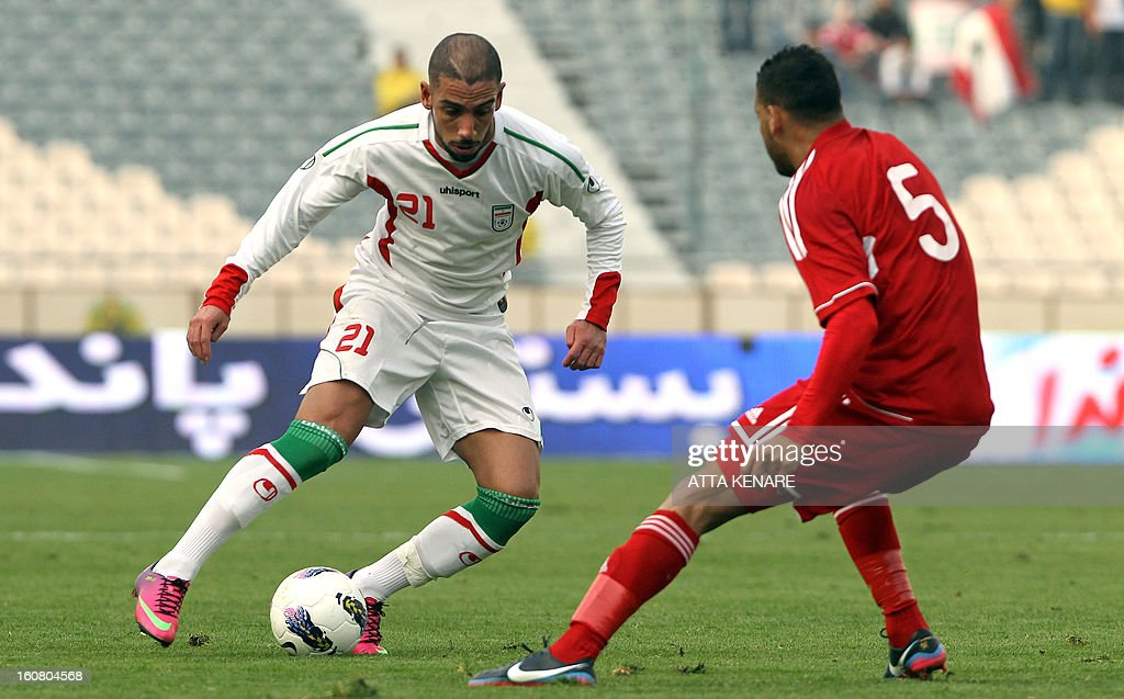 Lebanon`s Nour Mansour (R) fights for the ball against Ashkan Dejagah (L) of Iran during their 2015 AFC Asian Cup group B qualifying football match at the Azadi Stadium in Tehran on February 3, 2013. Iran won the match 5-0. AFP PHOTO/ATTA KENARE