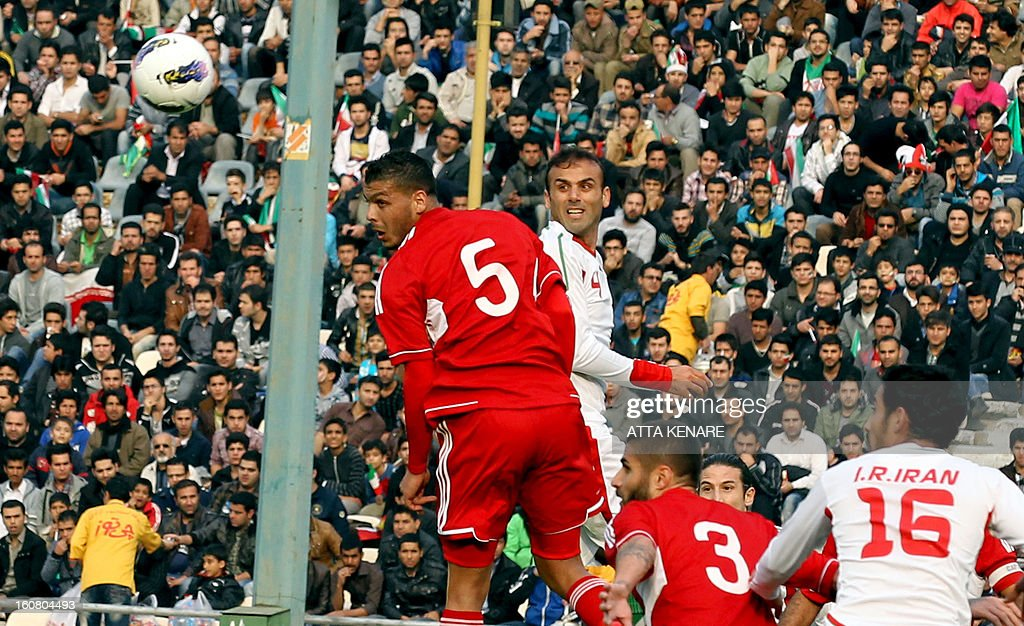 Lebanon's Nour Mansur (L) fights for the ball against Jalal Hosseini (C) of Iran during their 2015 AFC Asian Cup group B qualifying football match at the Azadi Stadium in Tehran, on February 3, 2013. Iran won the match 5-0.