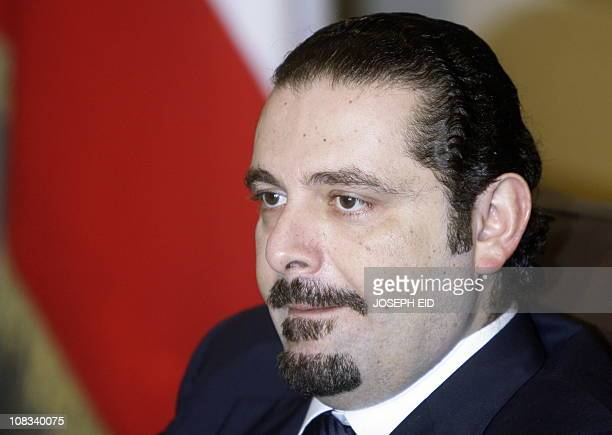 Lebanon's outgoing prime minister Saad Hariri contemplates during a meeting with his successor Najib Mikati at his house in downtown Beirut on...