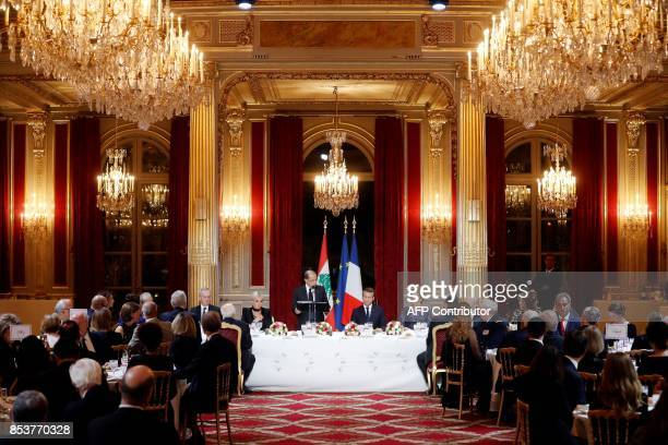 Lebanon's President General Michel Aoun delivers a speech next to French President Emmanuel Macron Aoun's wife Nadia Al Chami and the French...
