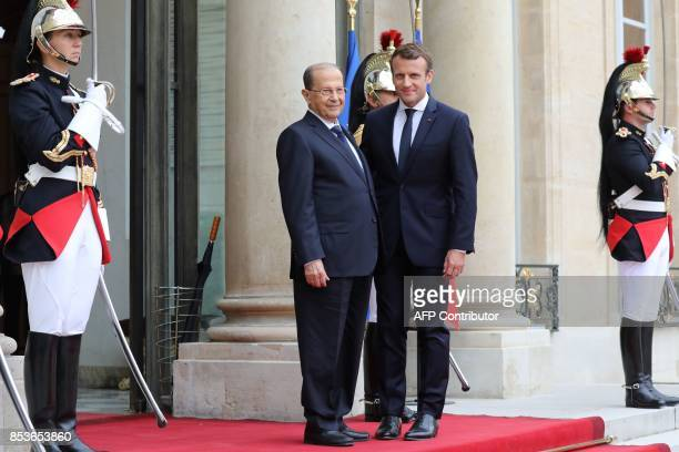 Lebanon's President General Michel Aoun is welcomed by French President Emmanuel Macron for a meeting at the Elysee Presidential Palace in Paris on...