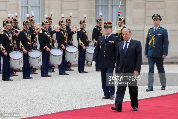 Lebanon's President General Michel Aoun reviews a military honour guard as he arrives for a meeting with the French President at the Elysee...