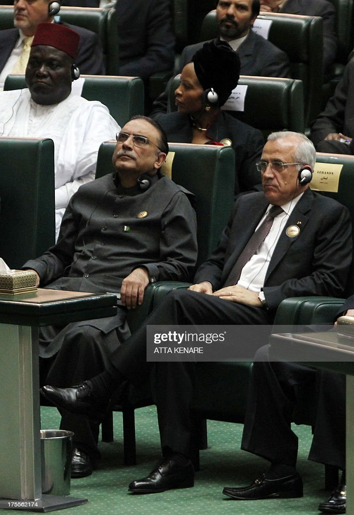 Lebanon's president, Michel Sleiman (R) and his Pakistani counterpart Asif Ali Zardari (L) listen to a speech by Iran's new president Hasan Rowhani after he was sworn in before parliament in Tehran on August 4, 2013. The Islamic republic's new president revealed a cabinet lineup of experienced technocrats, aiming to deliver on his promise of saving the economy and engaging the world.