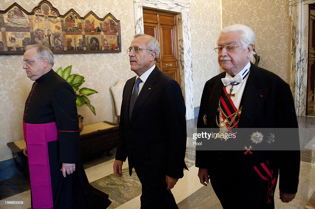 Lebanon's President <a gi-track='captionPersonalityLinkClicked' href=/galleries/search?phrase=Michel+Sleiman&family=editorial&specificpeople=2069358 ng-click='$event.stopPropagation()'>Michel Sleiman</a> (C) arrives at Vatican for a meeting with Pope Benedict XVI on November 23, 2012 in Vatican City, Vatican. The meeting comes ahead of the nomination of a new Lebanese cardinal, a move considered by observers as a sign of Vatican support for Lebanese religious diversity.