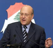 Lebanon's Prime Minister Najib Miqati holds a press conference 19 April 2005 to announce to his new government at the Baabda presidential palace on...