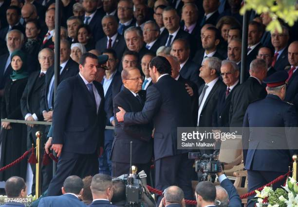 Lebanon's prime minister Saad Hariri is greeted by Lebanon's president Michel Aoun prior to the Independence Day ceremony on November 22 2017 in...