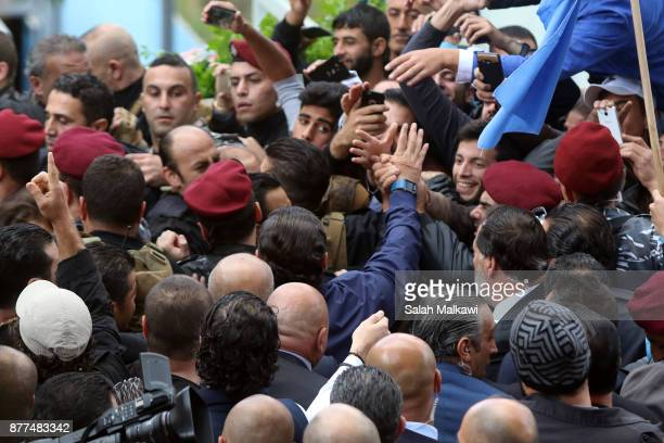 Lebanon's Prime Minister Saad Hariri is greeted by people as he makes a public appearance at his home 'Beit alWasat' November 22 2017 in Beirut...