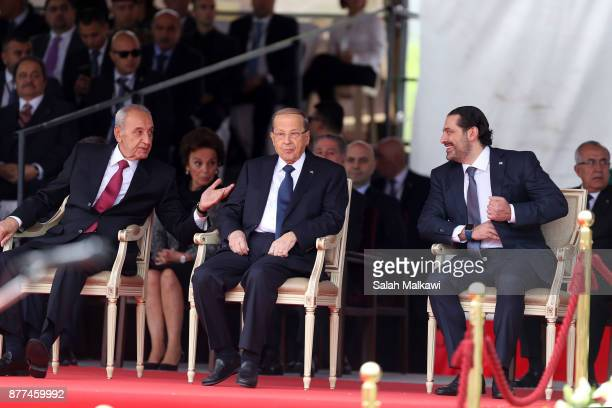 Lebanon's prime minister Saad Hariri sits next to Lebanese President Michel Aoun and speaker of parliament Nabih Berry the Independence Day ceremony...