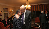 Lebanon's prime ministerdesignate Najib Mikati hugs an unidentified person at his residency in Beirut on January 25 2011 AFP PHOTO/ANWAR AMRO
