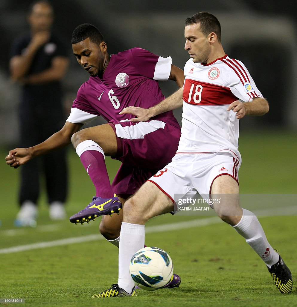 Lebanon's Walid Ismail (R) fights for the ball with Qatar's Abdul Aziz Hatem during their friendly football match in Doha January 31, 2013. Qatar won the match 1-0. AFP PHOTO / AL-WATAN DOHA / KARIM JAAFAR == QATAR OUT ==