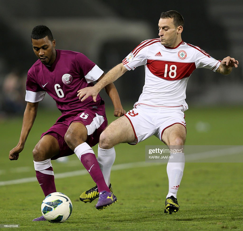 Lebanon's Walid Ismail (R) fights for the ball with Qatar's Abdul Aziz Hatem during their friendly football match in Doha January 31, 2013. Qatar won the match 1-0.