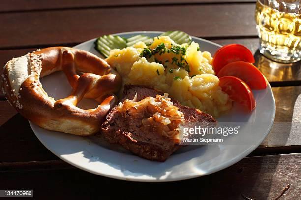 Leberkaese spam with roasted onions, pretzels and potato salad, Schwaben, Bavaria, Germany, Europe