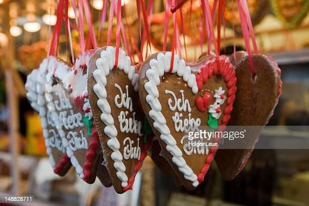 Lebkuchen gingerbread hearts for sale at market during Strand-und Heimatfest festival.