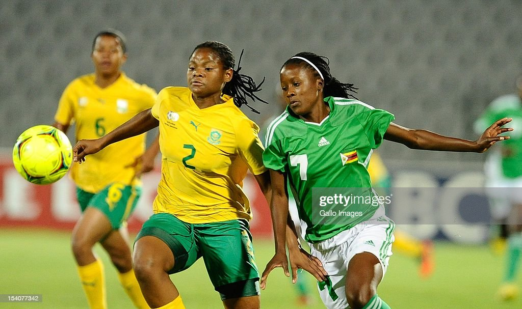 Lebogang Mabatle of South Africa and Rudo Neshamba (R) of Zimbabwe compete for the ball during the Womens International Friendly match between South Africa and Zimbabwe at Volkswagen Dobsonville Stadium on October 13, 2012 in Dobsonville, South Africa.