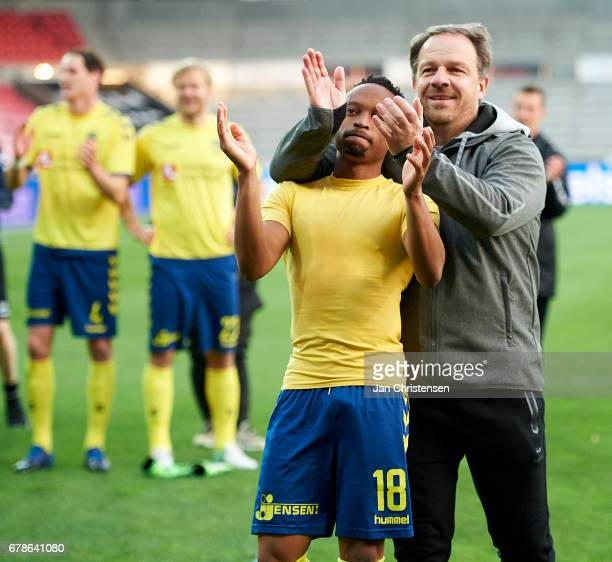 Lebogang Phiri of Brondby IF and Alexander Zorniger head coach of Brondby IF celebrate after the Danish Cup DBU Pokalen semifinal match between FC...