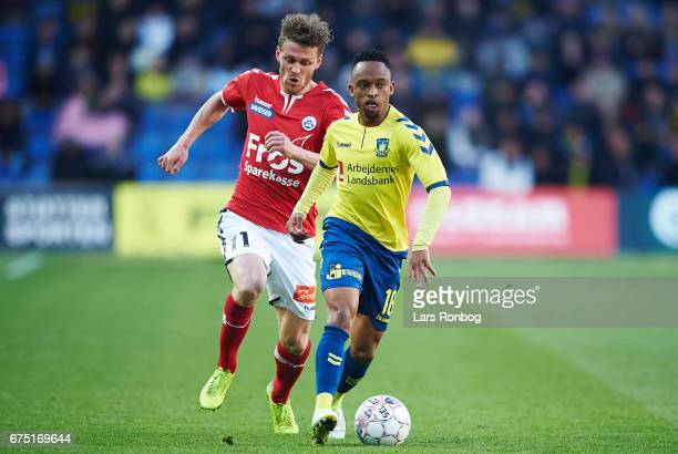 Lebogang Phiri of Brondby IF and Johan Absalonsen of Sonderjyske compete for the ball during the Danish Alka Superliga match between Brondby IF and...