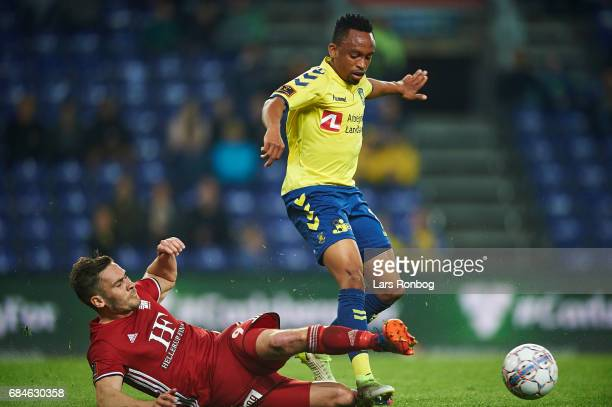 Lebogang Phiri of Brondby IF and Lasse Fosgaard of Lyngby BK compete for the ball during the Danish Alka Superliga match between Brondby IF and...