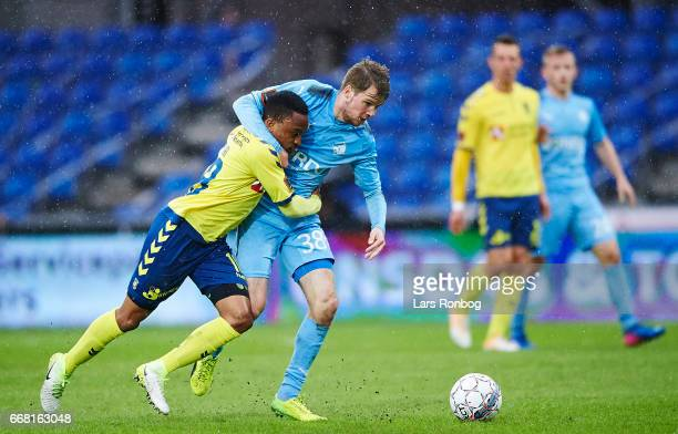 Lebogang Phiri of Brondby IF and Nicolai Poulsen of Randers FC compete for the ball during the Danish Cup DBU Pokalen quarterfinal match between...
