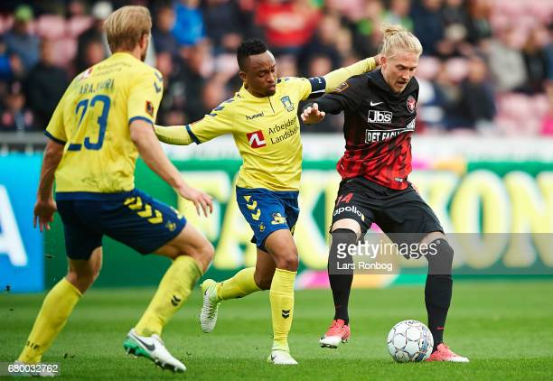 Lebogang Phiri of Brondby IF and Simon Kroon of FC Midtjylland compete for the ball during the Danish Alka Superliga match between FC Midtjylland and...