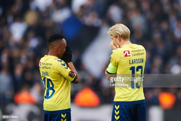 Lebogang Phiri of Brondby IF speaks to Johan Larsson of Brondby IF during the Danish Alka Superliga match between Brondby IF and FC Copenhagen at...
