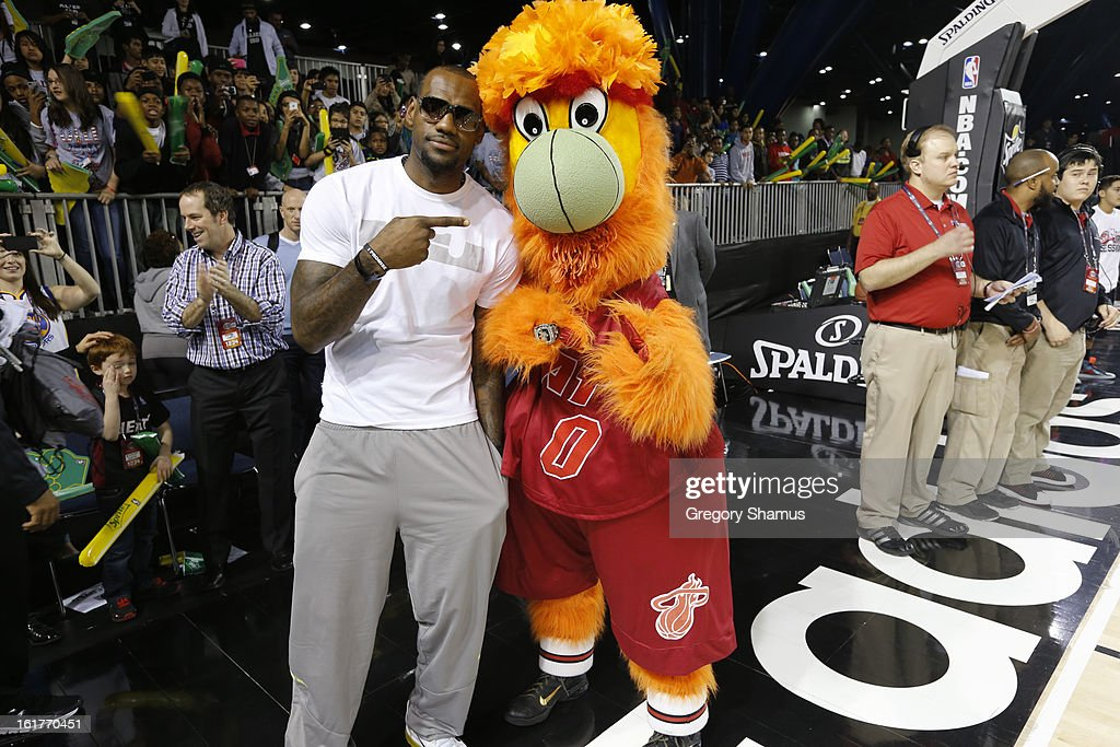 LeBron James a Coach of Team Sudden poses for a photo with Burnie Mascot of the Miami Heat before the Sprite Uncontainable Game in Sprint Arena during the 2013 NBA Jam Session on February 15, 2013 at the George R. Brown Convention Center in Houston, Texas.