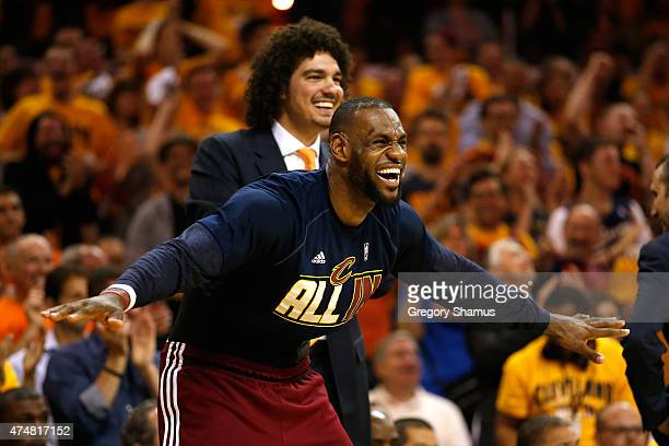 LeBron James and Anderson Varejao of the Cleveland Cavaliers react on the bench in the fourth quarter against the Atlanta Hawks during Game Four of...